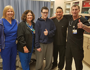 Andrew Karge visiting members of the Virtua Berlin emergency room - Patient Testimonial