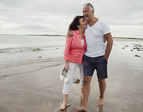 senior couple without diabetic foot wounds walking on beach